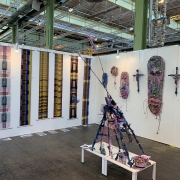 Scarfes by Scarlett Haasnoot and masks, crucifixes, and sculpture by Hab Vandenwijngaard at Art Nordic 2019